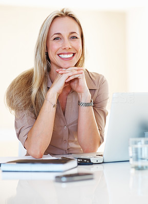 Buy stock photo Smiling business woman at her desk relaxing her hands on chin and smiling