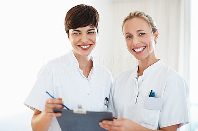 Buy stock photo Portrait of female healthcare professionals smiling and discussing medical report