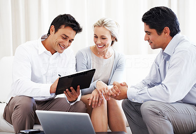 Buy stock photo Attractive couple with male consultant signing insurance contract