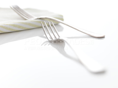 Buy stock photo Image of a two forks and a table cloth on white background