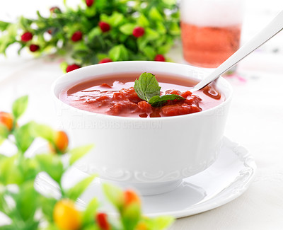 Buy stock photo Image of bowl of hot fresh tomato soup on dining table