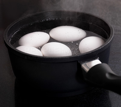 Buy stock photo Image of white eggs boiling in a pan of water for breakfast