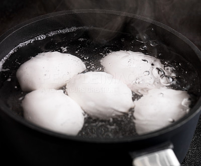Buy stock photo Closeup image of eggs cooking in a pot on stove