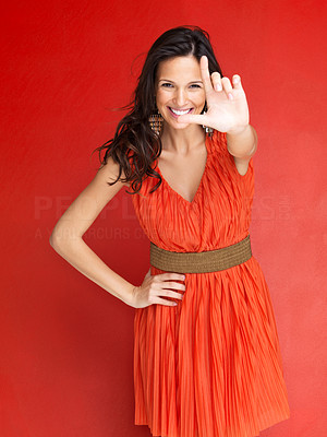 Buy stock photo Portrait of gorgeous woman making a loser gesture with her hand against red background