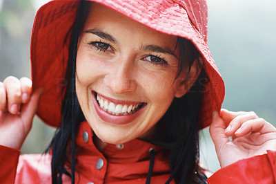 Buy stock photo Closeup of attractive woman holding rain hat