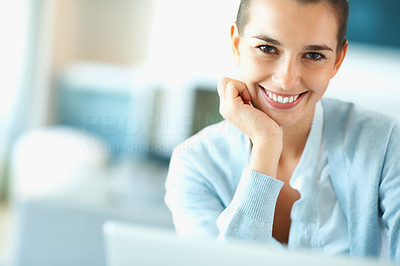 Buy stock photo Smiling woman in front of laptop resting her face on hand