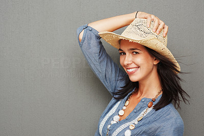Buy stock photo Pretty woman flirting while holding hat