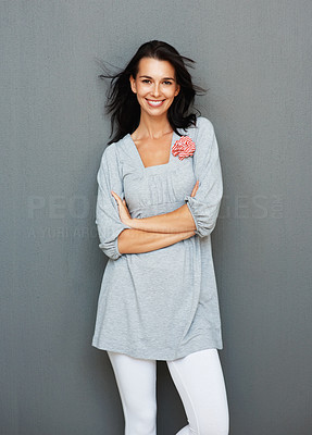 Buy stock photo Pretty woman smiling and standing with arms folded