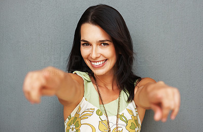 Buy stock photo Focus on woman's face as she's pointing toward you