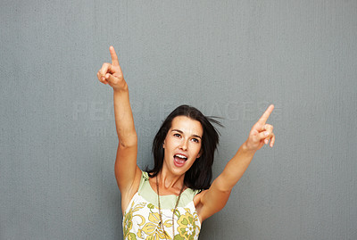 Buy stock photo Pretty woman pointing out with both arms