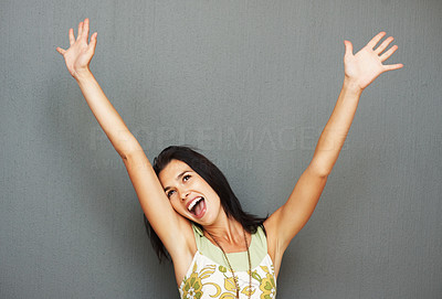 Buy stock photo Pretty woman holding arms up in air in excitement