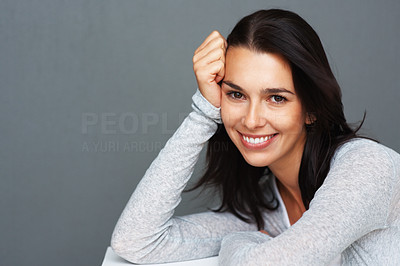 Buy stock photo Pretty young woman smiling with hand on face