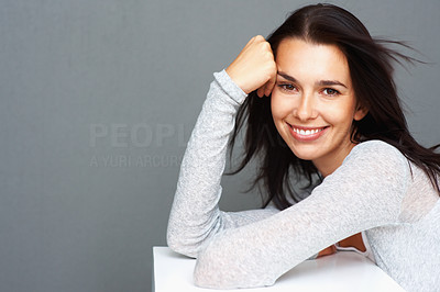 Buy stock photo Attractive woman sitting and holding hand to face