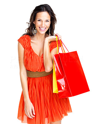 Buy stock photo Portrait of an attractive young female holding shopping bags against white background