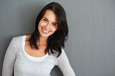 Buy stock photo Woman standing and tilting head against grey background