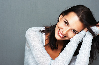 Buy stock photo Pretty woman leaning on her arms to the side and smiling