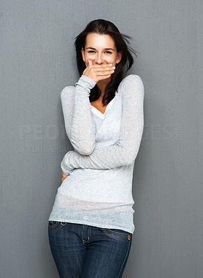 Buy stock photo View of woman covering her mouth while smiling