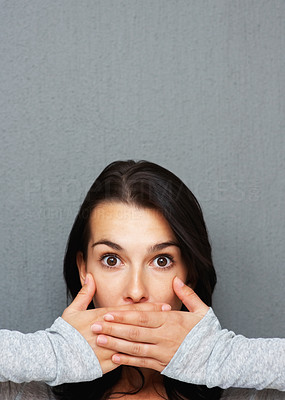 Buy stock photo Woman looking surprised as she covers her mouth