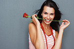 Flirtatious woman posing with rose