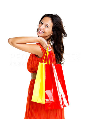 Buy stock photo Portrait of smiling young female carrying shopping bags against white background