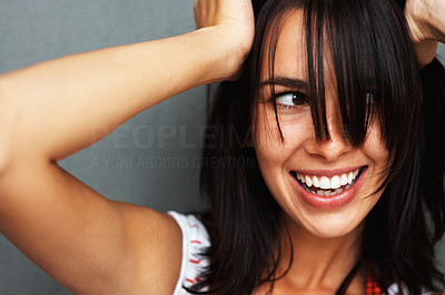 Buy stock photo Beautiful woman smiling with hands on head and looking to side