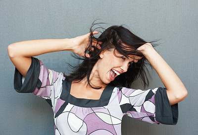 Buy stock photo Pretty woman running fingers through hair while dancing