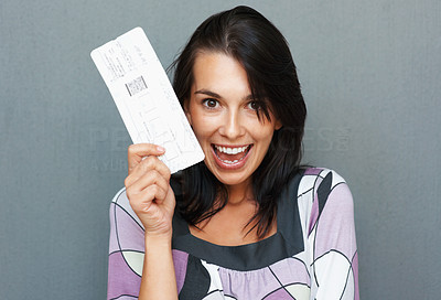 Buy stock photo Woman holding up airplane ticket and smiling