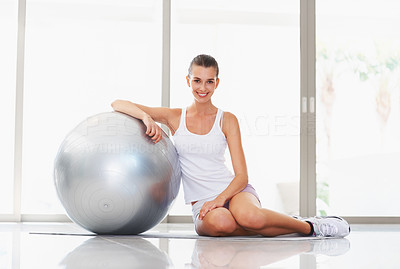 Buy stock photo Portrait of beautiful young woman posing with fitness ball