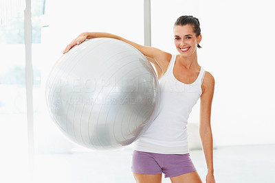 Buy stock photo Happy fit young woman holding fitness ball
