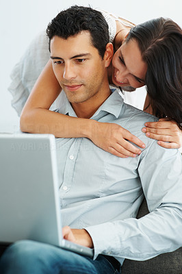 Buy stock photo Portrait of romantic young couple with laptop smiling