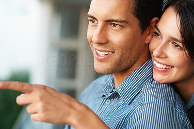 Buy stock photo Young smiling woman showing something to her boyfriend