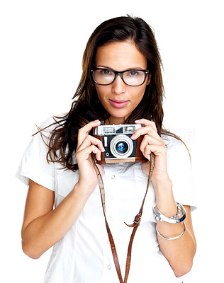 Buy stock photo Pretty young female wearing glasses holding an old camera against white background