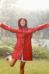 Woman enjoying rainy season