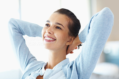 Buy stock photo Closeup of smiling woman sitting and relaxing at home