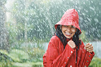Woman wearing red rain coat in the rain