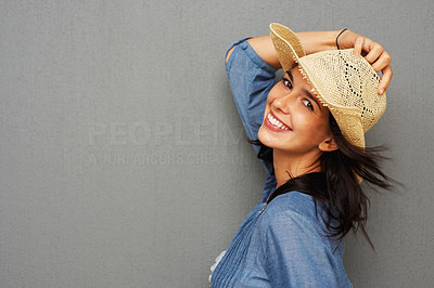 Buy stock photo Pretty young woman posing with hat and smiling - copyspace