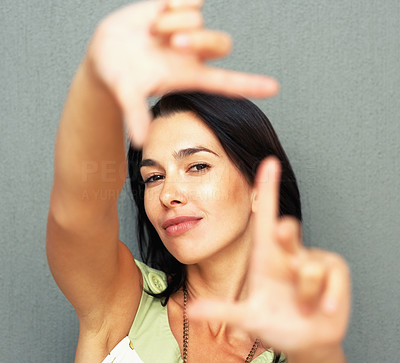 Buy stock photo Closeup of young beautiful woman making frame with her hands