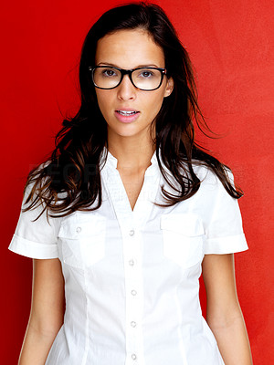 Buy stock photo Portrait of pretty young lady in glasses against red background