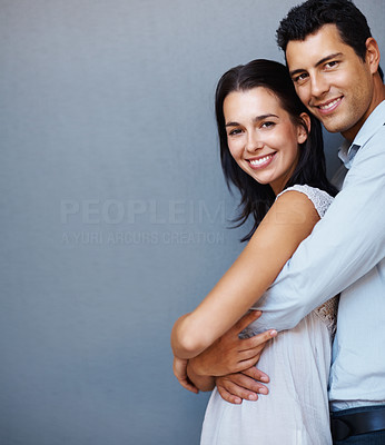 Buy stock photo Portrait of loving young man embracing woman from behind