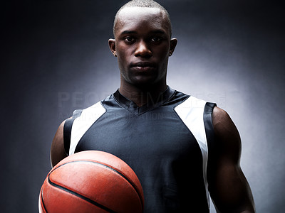 Buy stock photo Portrait of a confident young male basketball player looking with an atiitude against grunge background