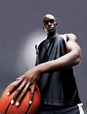 Buy stock photo Portrait of an afroamerican young man holding a basketball