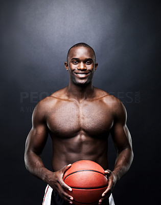 Buy stock photo Portrait of a fit young man holding a basketball against grunge background