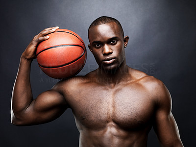 Buy stock photo Portrait of an afroamerican young man holding a basketball on shoulder  against grunge background