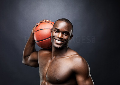 Buy stock photo Portrait of a muscular young man holding a basketball on shoulder against grunge background