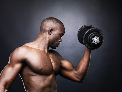 Buy stock photo Portrait of a fit young man doing workout with heavy dumbbell against grunge background
