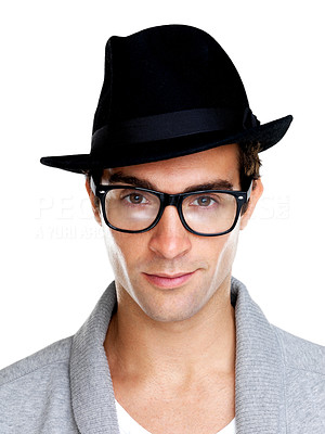 Buy stock photo Portrait of a relaxed young guy wearing a hat and glasses on a white background
