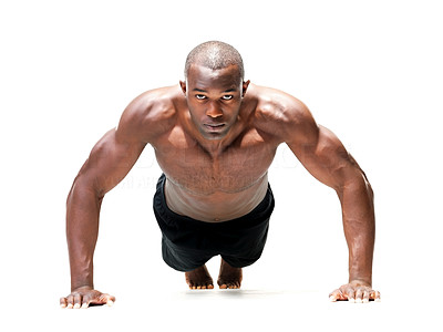 Buy stock photo Portrait of a young African American muscular man doing push-ups against a white background