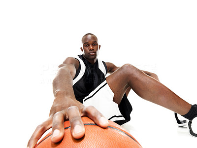 Buy stock photo Portrait of a young african american guy sitting with basketball over white background
