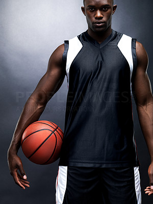 Buy stock photo Portrait of a young black basketball player male standing against grunge background