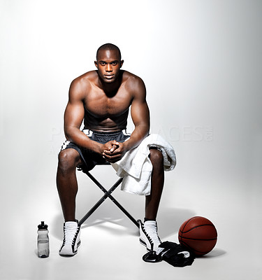Buy stock photo Portrait of  young basketball player resting after a game against grey  background